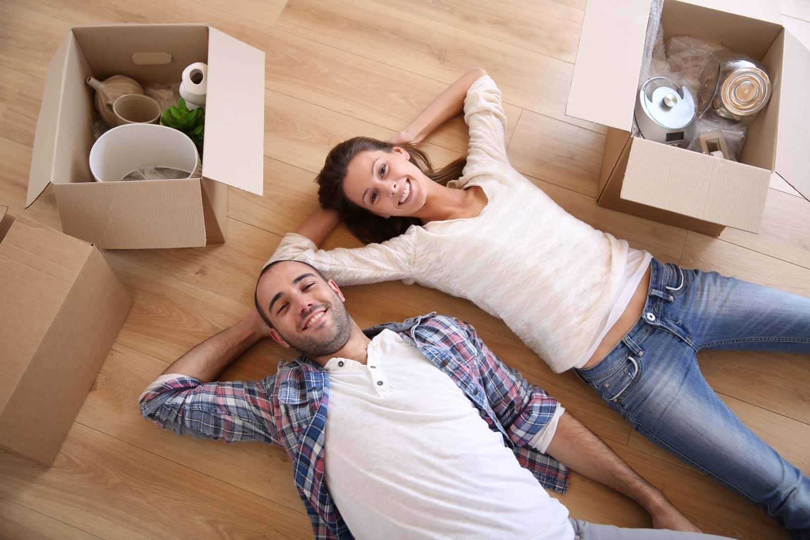 Young adults moving in new rented apartment
