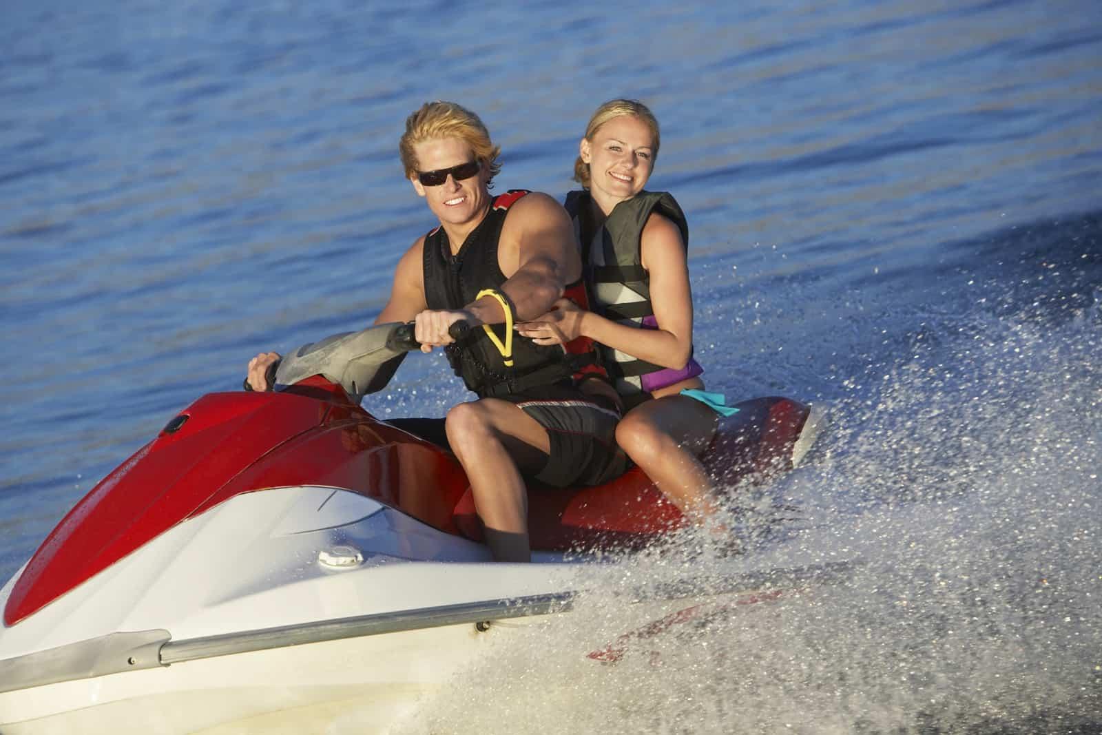 Happy couple riding jetski on Tampa Bay